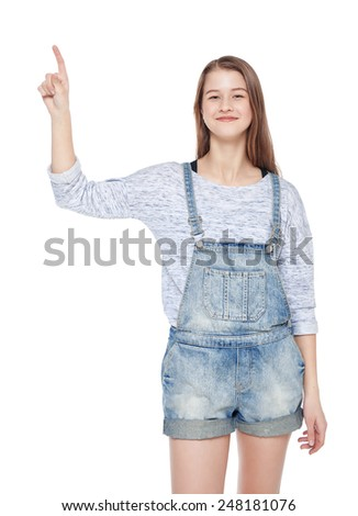 Young teenage girl showing on something by finger isolated  - stock photo