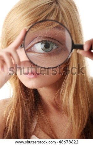 Young teenage girl with magnifier / searching and exploring concept - stock photo