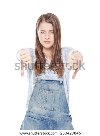 Young teenage girl with thumbs down gesture isolated on white background - stock photo