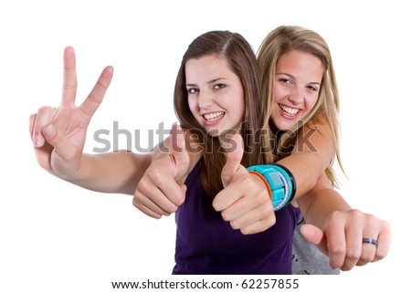 Young teenage girls with stylish clothes isolated over a white background. - stock photo