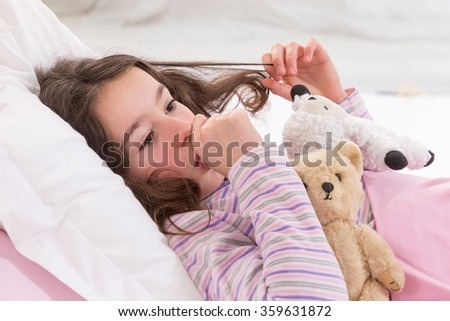 Young Teenager Asleep in Bed with Teddy Bear