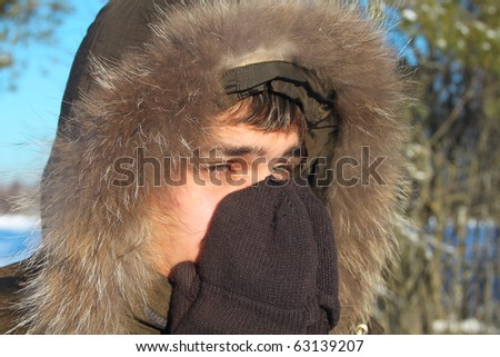Young teenager boy in winter coat - stock photo