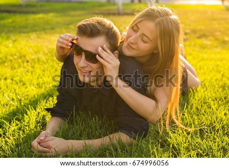 Young teenager couple have fun in a meadow