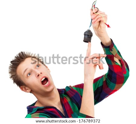 Young teenager getting electric shock - conceptual image. - stock photo