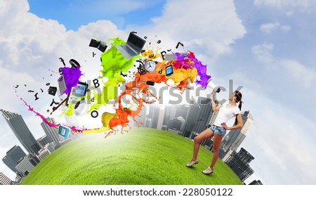 Young teenager girl in shorts screaming in megaphone