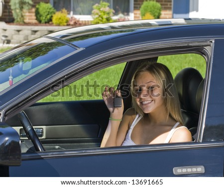 Young teenager girl learning how to drive - stock photo