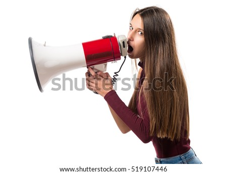 Young teenager girl shouting by megaphone