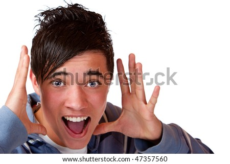 Young teenager holding his hands beside head and anounce interesting news. - stock photo