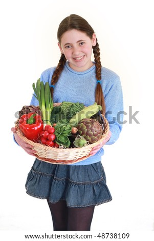 young teenager with a vegetables basket