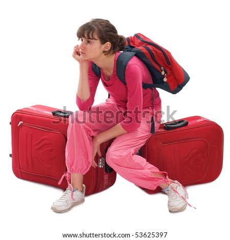 Young teenager with huge luggage and haversack wait a taxi - stock photo