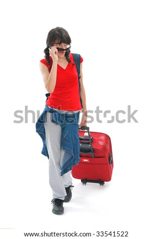 Young teenager with huge luggage and sunglasses - stock photo