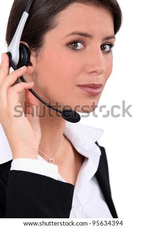 Young telephone operator - stock photo