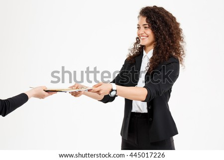 Young tender curly girl holding documents over white background