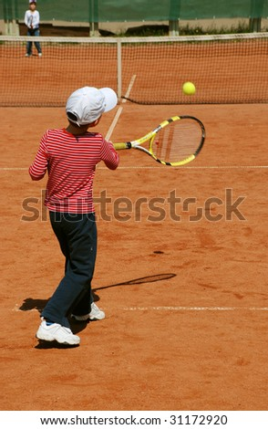 young tennis player ready to hit the ball - stock photo