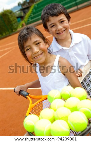 Young tennis players or caddies holding a racket with balls - stock photo