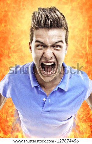 Young terrified man crying in fire. Concept for judgment day. - stock photo