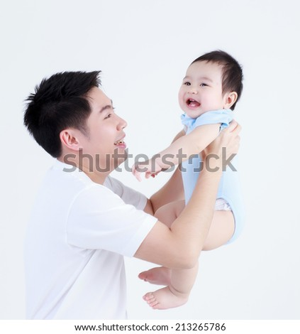 Young Thai dad and son smile happily isolated - stock photo