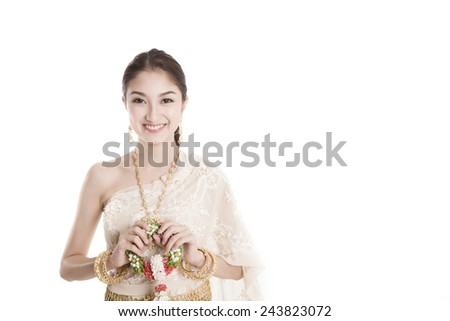 Young Thai lady in traditional costume holding garland isolated background - stock photo