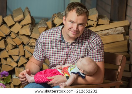 Young the man holds the small child - stock photo