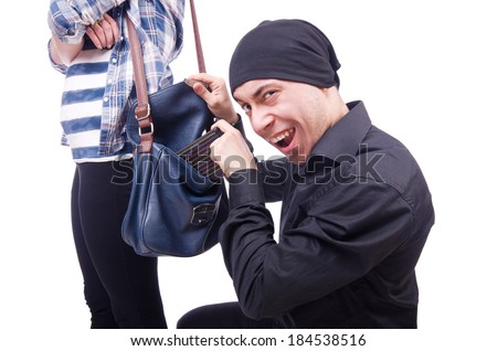 Young thief stealing woman's bag - stock photo