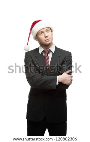 young thoughtful caucasian businessman in black suit and santa hat isolated on white - stock photo