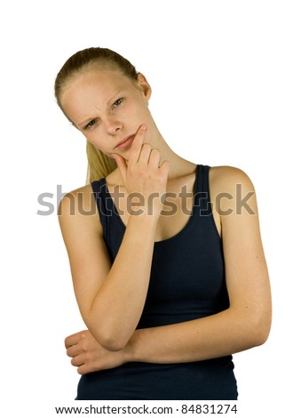 Young thoughtful woman on white background - stock photo