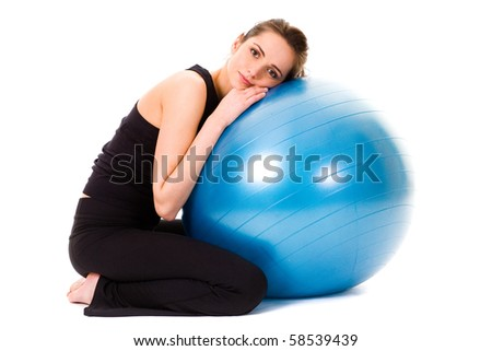 young tired and very attractive woman with blue fitness ball, studio shoot isolated on white background - stock photo