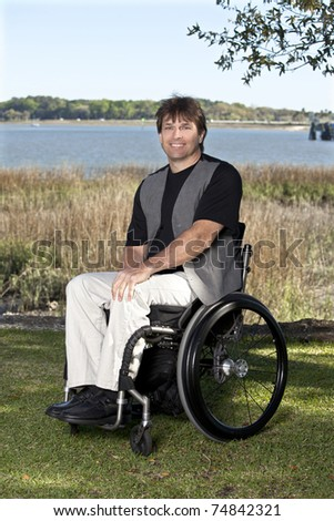 young to middle-age man in wheelchair - stock photo
