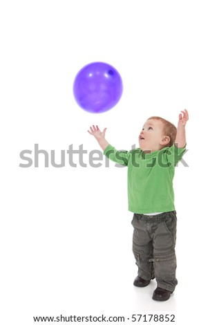 Young toddler boy throwing and catching purple balloon. Isolated on white - stock photo
