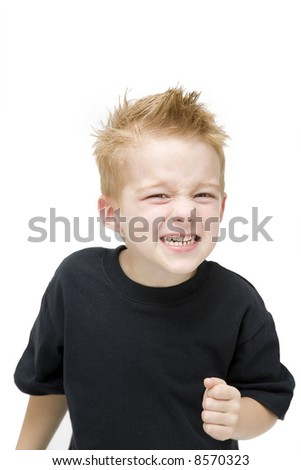 young toddler pulling an angry face - stock photo