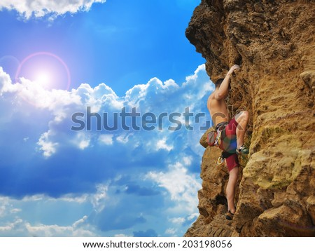 Young tourist climbing on mountain - stock photo