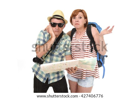 young tourist couple reading city map looking lost and confused loosing orientation with girl carrying travel backpack and man in frustrated face expression isolated white background - stock photo