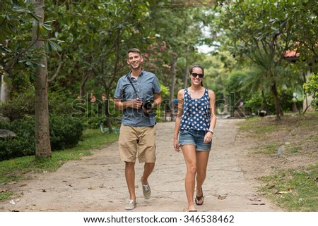 Young tourist couple travel holiday and photographing camera