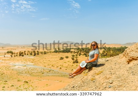 Young tourist in Tafilalt oasis in Morocco  - stock photo