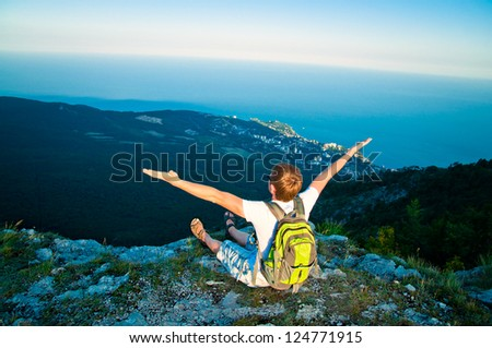 young tourist with a backpack on a mountain