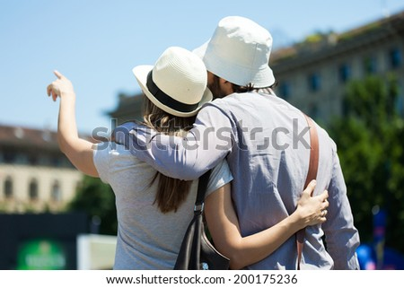 Young tourists couple in the city - stock photo