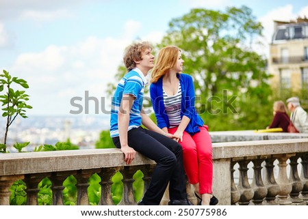 Young tourists in Paris, on the Montmartre hill - stock photo