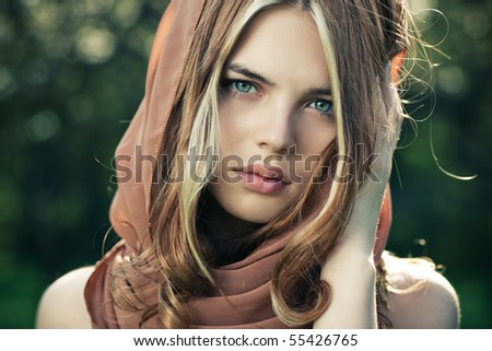 Young tranquil woman outdoors portrait. - stock photo