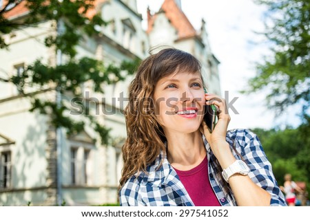 Young travel woman using cell phone talking on phone - stock photo