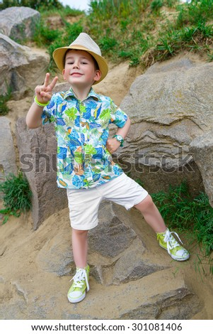 Young traveler in hat over stone background - stock photo