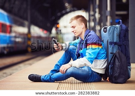 Young traveler is waiting at the railway station  - stock photo