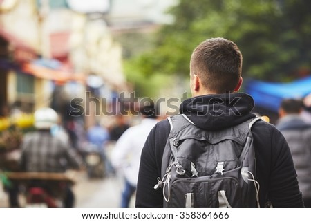 Young traveler with back pack - Hanoi, Vietnam - stock photo