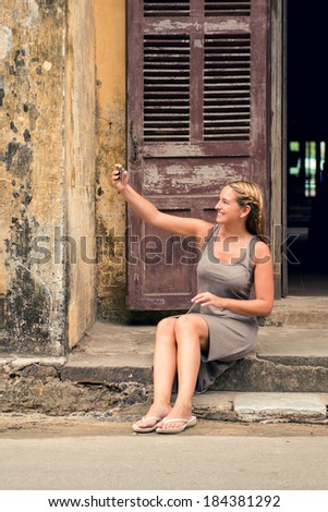 Young traveler woman taking a selfie in foreign city - stock photo