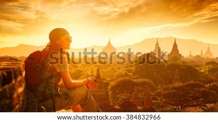 Young traveller enjoying a looking at sunset on Bagan, Myanmar Asia. Panoramic view. Traveling along Asia, active lifestyle concept.  - stock photo