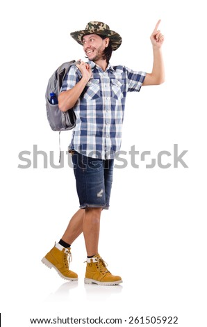 Young traveller with backpack pointing isolated on white - stock photo