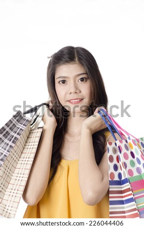 Young trendy girl holding up shopping bag