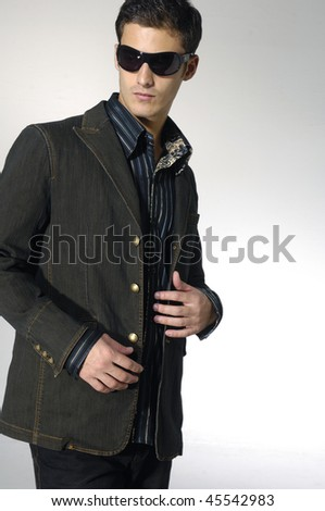 young trendy male model posing isolated over white - stock photo