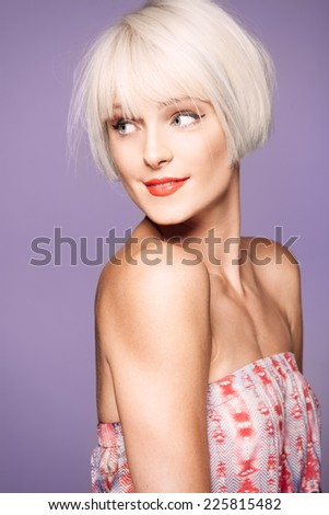 Young trendy woman on purple background  - stock photo