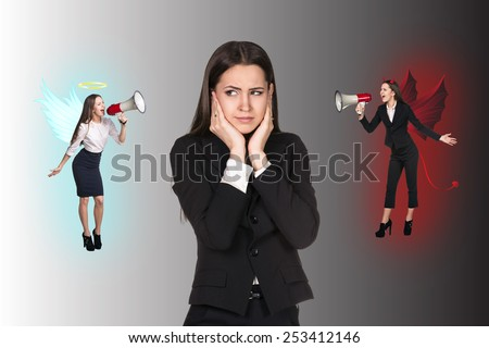 Young troubled businesswoman making choice between good and bad on grey background - stock photo