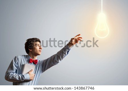 Young troubled man with notepad in hands - stock photo